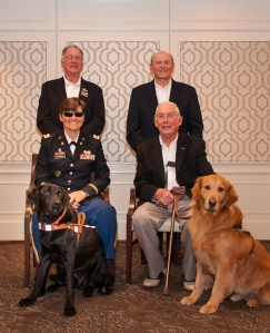 Mr. Stovroff & Cash (right) gather with Ret'd Lt. Col Kathy Champion (left) with her service dog, George.